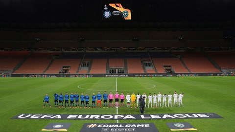 <p>               Inter Milan, left, and Ludogorets line-up inside the empty San Siro stadium in Milan, Italy ahead of their Europa League round of 32 second leg soccer match Thursday Feb. 27, 2020. Inter beat Ludogorets 2-1 in an empty stadium as a precaution because of the virus outbreak in Italy. (Emilio Andreoli, UEFA via AP )             </p>