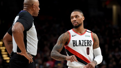 <p>               Portland Trail Blazers guard Damian Lillard, right, speaks with referee Kevin Cutler, left, during the first half of an NBA basketball game against the Utah Jazz in Portland, Ore., Saturday, Feb. 1, 2020. (AP Photo/Steve Dykes)             </p>