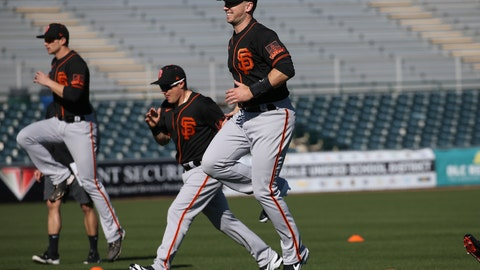 <p>               San Francisco Giants catcher Buster Posey, right, jumps in the air as he warms up with teammates during spring training baseball workouts for pitchers and catchers Wednesday, Feb. 12, 2020, in Scottsdale, Ariz. (AP Photo/Ross D. Franklin)             </p>