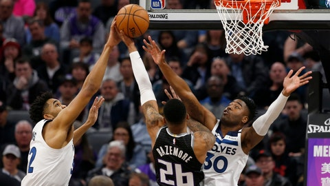 <p>               Minnesota Timberwolves center Karl-Anthony Towns, left, blocks the shot of Sacramento Kings guard Kent Bazemore, center, as he goes to the basket against Timberwolves forward Kelan Martin, right, during the first quarter of an NBA basketball game in Sacramento, Calif., Monday, Feb. 3, 2020. . (AP Photo/Rich Pedroncelli)             </p>