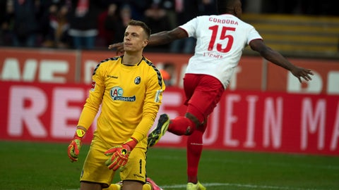 <p>               Cologne's Jhon Cordoba celebrates scoring his side's second goal of the game as Freiburg's goalkeeper Alexander Schwolow, left, looks dejected during their German Bundesliga soccer match between FC Cologne and SC Freiburg at the RheinEnergie Stadium in Cologne, Germany, Sunday, Feb. 2, 2020. (Federico Gambarini/dpa via AP)             </p>