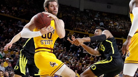 <p>               Arizona State's Mickey Mitchell (00) wins a loose ball against Oregon's Chandler Lawson (13) during the first half of an NCAA college basketball game Thursday, Feb. 20, 2020, in Tempe, Ariz. (AP Photo/Darryl Webb)             </p>