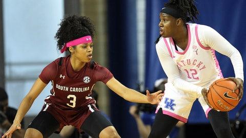 <p>               Kentucky's Amanda Paschal (12)  keeps the ball away from South Carolina's Destanni Henderson (3) during the first half of an NCAA college basketball game in Lexington, Ky., Sunday, Feb. 23, 2020. (AP Photo/James Crisp)             </p>
