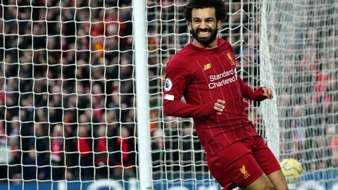 <p>               Liverpool's Mohamed Salah celebrates after scoring his sides third goal during the English Premier League soccer match between Liverpool and Southampton at Anfield Stadium, Liverpool, England, Saturday, February 1, 2020. (AP Photo/Jon Super)             </p>