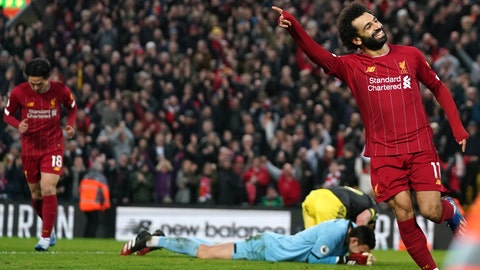 <p>               Liverpool's Mohamed Salah celebrates after scoring his sides fourth goal during the English Premier League soccer match between Liverpool and Southampton at Anfield Stadium, Liverpool, England, Saturday, February 1, 2020. (AP Photo/Jon Super)             </p>