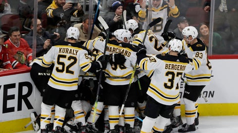 <p>               Boston Bruins defenseman Charlie McAvoy (73) celebrates with teammates after scoring against the Chicago Blackhawks during overtime in an NHL hockey game in Chicago, Wednesday, Feb. 5, 2020. The Bruins won 2-1. (AP Photo/Nam Y. Huh)             </p>