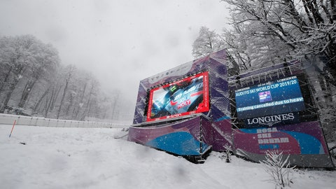 <p>               Writing on a giant screen announced that an alpine ski, women's World Cup downhill training is canceled due to heavy snow, in Rosa Khutor, Russia, Friday, Jan. 31, 2020. (AP Photo/Gabriele Facciotti)             </p>