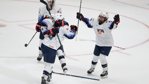 <p>               U.S. players celebrate Megan Bozek's overtime goal against Canada in a Rivalry Series hockey game in Anaheim, Calif., Saturday, Feb. 8, 2020. The United States won 4-3 and won the series. (AP Photo/Chris Carlson)             </p>