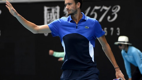 <p>               In this Jan. 27, 2020, photo, Russia's Daniil Medvedev gestures to Switzerland's Stan Wawrinka after his ball hit the net during their fourth round singles match at the Australian Open tennis championship in Melbourne, Australia. It might just be the most insincere gesture in sports: A tennis player signals an apology after a ball clips the net tape and trickles over, producing a winner, an obviously accidental winner, to end a point. (AP Photo/Andy Brownbill)             </p>