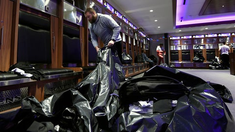 <p>               Baltimore Ravens guard James Hurst fills bags with items from his locker, Sunday, Jan. 12, 2020 in Owings Mills, MD. (AP Photo/Gail Burton)             </p>