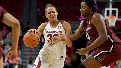 <p>               Arkansas guard Chelsea Dungee(33) is fouled by South Carolina defender Aliyah Boston during the first half of an NCAA college basketball game Thursday, Feb. 6, 2020, in Fayetteville, Ark. (AP Photo/Michael Woods)             </p>