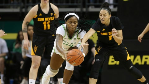 <p>               Oregon's Ruthy Hebard, center, battles Arizona State's Robbi Ryan, left, and Reili Richardson, right, for the ball during the first quarter of an NCAA college basketball game in Eugene, Ore., Sunday, Feb. 9, 2020. (AP Photo/Chris Pietsch)             </p>