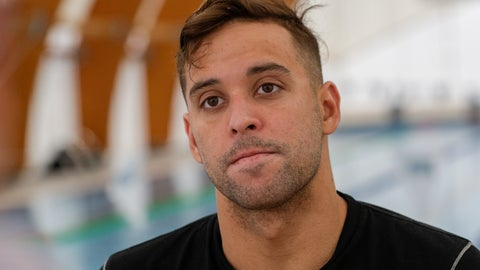<p>               South African swimmer Chad Le Clos listens to questions during an interview with The Associated Press, in Naples, Wednesday, Feb. 26, 2020. If any thoughts were creeping into their minds that the Tokyo Olympics might be canceled due to a viral outbreak, elite swimmers Katinka Hosszú, Chad le Clos and Sarah Sjöström certainly didn't show it during a strenuous two-hour training session Wednesday.(AP Photo/Andrew Medichini)             </p>