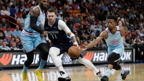 <p>               Dallas Mavericks guard Luka Doncic (77) drives to the basket against Miami Heat forwards Jae Crowder, left, and Jimmy Butler (22) during the first half of an NBA basketball game, Friday, Feb. 28, 2020, in Miami. (AP Photo/Wilfredo Lee)             </p>