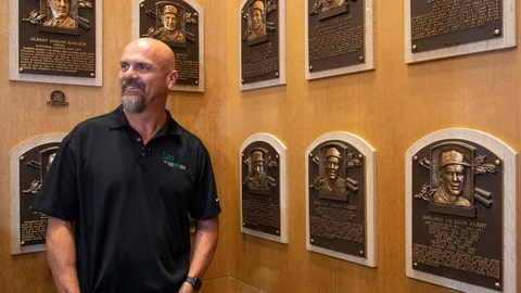 """<p>               In this photo provided by the National Baseball Hall of Fame and Museum, Larry Walker poses near the wall of plaques, Tuesday, Feb. 25, 2020 at the National Baseball Hall of Fame in Cooperstown, N.Y. Walker said on Tuesday that his Hall of Fame plaque will show him in Colorado Rockies cap, not a Montreal Expos hat. He added the key to picking the Rockies is that Colorado was """"where the majority of my damage was done."""" (Milo Stewart, Jr./National Baseball Hall of Fame and Museum via AP)             </p>"""