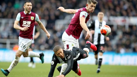 <p>               Newcastle United's Dwight Gayle, below, and Burnley's James Tarkowski battle for the ball during their English Premier League soccer match at St James' Park, Newcastle, England, Saturday, Feb, 29, 2020. (Owen Humphreys/PA via AP)             </p>
