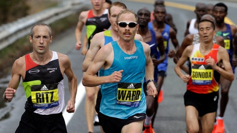 <p>               FILE - In this April 15, 2019, file photo, Jared Ward, center, of Mapleton, Utah, leads the pack in front as they run the course during the 123rd Boston Marathon in Natick, Mass. Footwear will be a the forefront at the U.S. Olympic marathon trials this weekend in Atlanta. No matter what time the marathoners turn in or how well they run, the they know their shoes will be the real headliner.(AP Photo/Steven Senne, File)             </p>