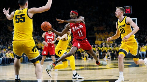 <p>               Nebraska guard Dachon Burke Jr. (11) drives to the basket between Iowa's Luka Garza (55) and Joe Wieskamp (10 during the first half of an NCAA college basketball game, Saturday, Feb. 8, 2020, in Iowa City, Iowa. (AP Photo/Charlie Neibergall)             </p>