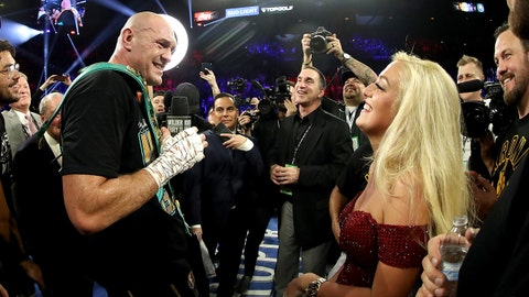 "LAS VEGAS, NEVADA - FEBRUARY 22:  Tyson Fury sings ""American Pie"" to his wife Paris Fury and the fans following his win by TKO in the seventh round against Deontay Wilder in the Heavyweight bout for Wilder's WBC and Fury's lineal heavyweight title on February 22, 2020 at MGM Grand Garden Arena in Las Vegas, Nevada. (Photo by Al Bello/Getty Images)"