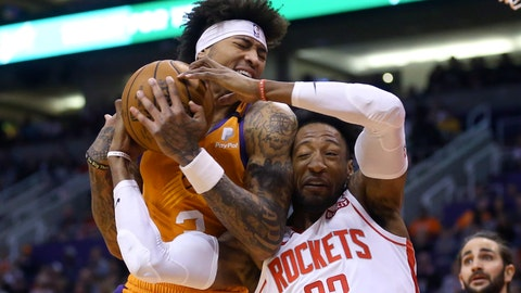 <p>               Phoenix Suns forward Kelly Oubre Jr., left, pulls a rebound away from Houston Rockets forward Robert Covington (33) as Suns guard Ricky Rubio, right, looks on during the first half of an NBA basketball game Friday, Feb. 7, 2020, in Phoenix. (AP Photo/Ross D. Franklin)             </p>