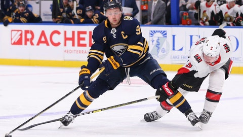 <p>               Buffalo Sabres forward Jack Eichel (9) and Ottawa Senators defensemen Mike Reilly (5) compete for the puck during the third period of an NHL hockey game Tuesday, Jan. 28, 2020, in Buffalo, N.Y. (AP Photo/Jeffrey T. Barnes)             </p>