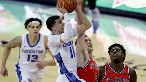 <p>               Creighton's Marcus Zegarowski (11) goes to the basket against St. John's David Caraher (5), with Jordan Scurry (12) and Marcellus Earlington (10) watching, during the first half of an NCAA college basketball game in Omaha, Neb., Saturday, Feb. 8, 2020. (AP Photo/Nati Harnik)             </p>