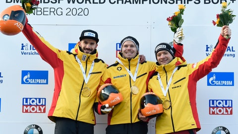<p>               Christopher Grotheer from Germany, center, celebrates his victory with runner up Axel Jungk, left, and third placed Alexander Gassner, both from Germany, after the Skeleton competition at the Bobsleigh and Skeleton World Championships in Altenberg, eastern Germany, Friday, Feb. 28, 2020. (AP Photo/Jens Meyer)             </p>