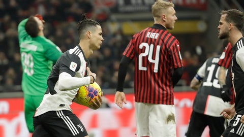 <p>               Juventus' Cristiano Ronaldo, second left, celebrates after scoring his side's opening goal from the penalty spot during an Italian Cup soccer match between AC Milan and Juventus at the San Siro stadium, in Milan, Italy, Thursday, Feb. 13, 2020. (AP Photo/Luca Bruno)             </p>