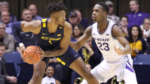 <p>               West Virginia forward Derek Culver (1) goes to pass the ball as he is defended by Kansas State forward Montavious Murphy (23) during the first half of an NCAA college basketball game Saturday, Feb. 1, 2020, in Morgantown, W.Va. (AP Photo/Kathleen Batten)             </p>