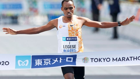 <p>               Ethiopia's Birhanu Legese crosses the finish line to win the Tokyo Marathon in Tokyo Sunday, March 1, 2020. The race was scaled back as part of Japan's efforts to combat the spread of the coronavirus. (Masanori Takei/Kyodo News via AP)             </p>