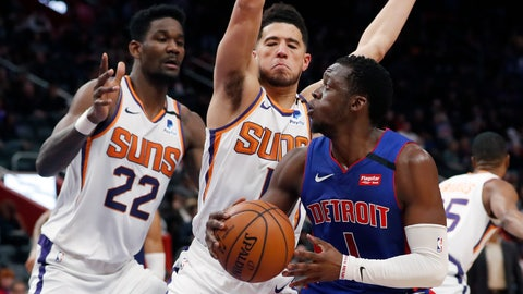 <p>               Detroit Pistons guard Reggie Jackson (1) is defended by Phoenix Suns guard Devin Booker (1) and center Deandre Ayton (22) during the second half of an NBA basketball game, Wednesday, Feb. 5, 2020, in Detroit. (AP Photo/Carlos Osorio)             </p>