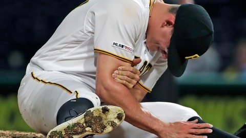 <p>               FILE - In this April 22, 2019, file photo, Pittsburgh Pirates relief pitcher Nick Burdi holds his right arm after delivering a pitch during the eighth inning of a baseball game against the Arizona Diamondbacks in Pittsburgh. Burdi is back with the Pirates,  one rib lighter and optimistic his issues with thoracic outlet syndrome are behind him. (AP Photo/Gene J. Puskar, File)             </p>