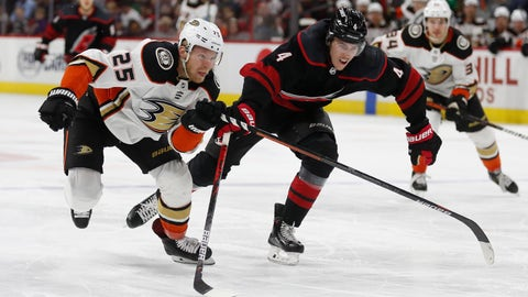 <p>               Anaheim Ducks right wing Ondrej Kase (25), of the Czech Republic, and Carolina Hurricanes defenseman Haydn Fleury (4) chase the puck during the third period of an NHL hockey game in Raleigh, N.C., Friday, Jan. 17, 2020. Anaheim won 2-1 in overtime. (AP Photo/Gerry Broome)             </p>