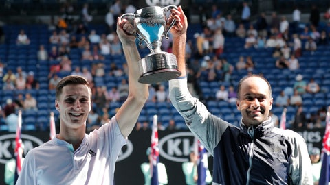 <p>               Rajeev Ram, right, of the U.S. and partner Britain's Joe Salisbury hold their trophy aloft after defeating Australia's Max Purcell and Luke Saville in the men's doubles final at the Australian Open tennis championship in Melbourne, Australia, Sunday, Feb. 2, 2020. (AP Photo/Lee Jin-man)             </p>