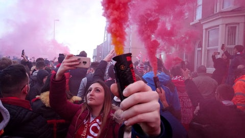 <p>               Football supporters set off flares before the English Premier League soccer match between Liverpool and Manchester United near Anfield Stadium in Liverpool, Sunday, Jan. 19, 2020.(AP Photo/Jon Super)             </p>