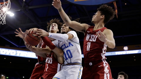 <p>               UCLA guard Tyger Campbell (10) vies for a rebound against Washington State guard Jervae Robinson (1) and forward DJ Rodman (11) during the first half of an NCAA college basketball game Thursday, Feb. 13, 2020, in Los Angeles. (AP Photo/Marcio Jose Sanchez)             </p>