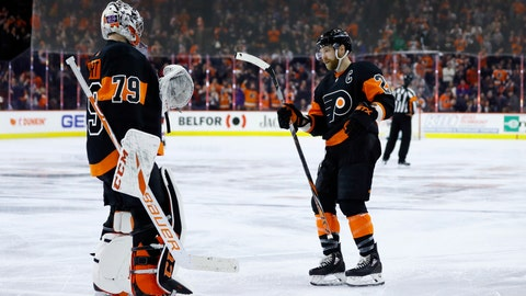 <p>               Philadelphia Flyers' Claude Giroux, right, and Carter Hart celebrate after a goal by Giroux during the third period of an NHL hockey game against the New York Rangers, Friday, Feb. 28, 2020, in Philadelphia. Philadelphia won 5-2. (AP Photo/Matt Slocum)             </p>