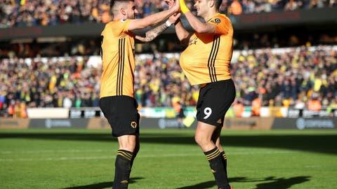 <p>               Wolverhampton Wanderers' Raul Jimenez, right, celebrates scoring against Norwich City during the English Premier League soccer match at Molineux, Wolverhampton, England, Sunday Feb. 23, 2020. (Nick Potts/PA via AP)             </p>