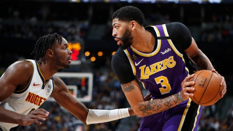 <p>               Los Angeles Lakers forward Anthony Davis, right, looks to pass the ball as Denver Nuggets forward Jerami Grant defends during the first half of an NBA basketball game Wednesday, Feb. 12, 2020, in Denver. (AP Photo/David Zalubowski)             </p>