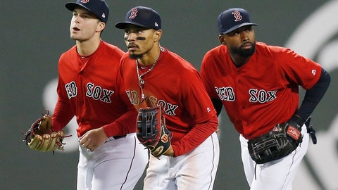 """<p>               FILE - In this Friday, April, 12, 2019 file photo, Boston Red Sox's Andrew Benintendi, left, Mookie Betts, center, and Jackie Bradley Jr. run in after defeating the Baltimore Orioles during a baseball game in Boston. When the Boston Red Sox traded Mookie Betts to the Los Angeles Dodgers on the eve of spring training, they broke up the """"Killer B's"""" who patrolled the Fenway outfield and led the team to a World Series championship in 2018. Together, Betts, Jackie Bradley Jr. and Andrew Benintendi formed one of the best outfields in baseball. (AP Photo/Michael Dwyer, File)             </p>"""
