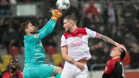 <p>               Duesseldorf's Andre Hoffmann, right, and  Berlin goalkeeper Thomas Kraft in action during the Bundesliga soccer match in the Merkur Spiel-Arena, Duesseldorf, Germany, Friday Feb. 28, 2020. (Bernd Thissen/dpa via AP)             </p>