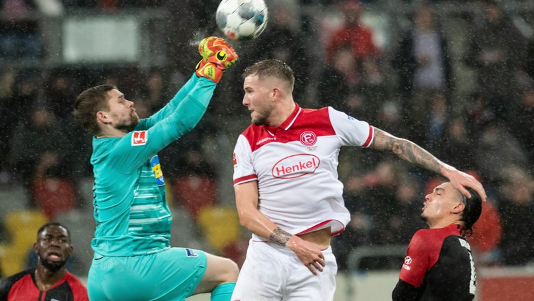 Hertha comes from 3 goals down to save face in Düsseldorf