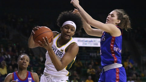 <p>               Baylor forward NaLyssa Smith (1) rebounds the ball against Kansas forward Mariane De Carvalho (4) in the first half of an NCAA college basketball game Wednesday, Feb. 5, 2020, in Waco, Texas. (AP Photo/Jerry Larson)             </p>