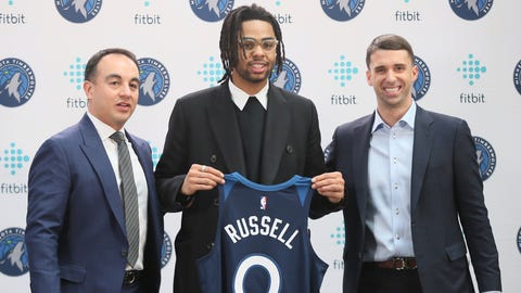 <p>               New Minnesota Timberwolves NBA basketball player D'Angelo Russell, center, holds his new jersey between President of Basketball Operations Gersson Rosas, left, and head coach Ryan Saunders during his introduction to the media, Friday, Feb. 7, 2020, in Minneapolis, following a trade that sent Timberwolves' Andrew Wiggins to the Golden State Warriors. (AP Photo/Jim Mone)             </p>