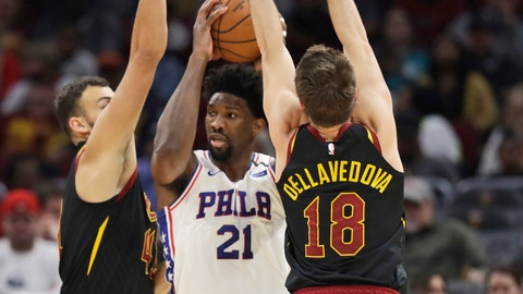 <p>               Philadelphia 76ers' Joel Embiid, center, squeezes between Cleveland Cavaliers' Ante Zizic, left and Matthew Dellavedova in the first half of an NBA basketball game, Wednesday, Feb. 26, 2020, in Cleveland. (AP Photo/Tony Dejak)             </p>