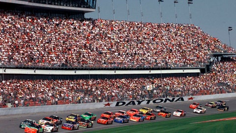 """<p>               FILE - In this Feb. 11, 1999, file photo, drivers in the first 125-mile Daytona 500 qualifying race start the race at Daytona International Speedway in Daytona Beach, Fla. Daytona Beach became the unofficial """"Birthplace of Speed"""" in 1903 when two men argued over who had the fastest horseless carriage and decided things in a race on the white, hard packed sand along the Atlantic Ocean.(AP Photo/Chris O'Meara, File)             </p>"""