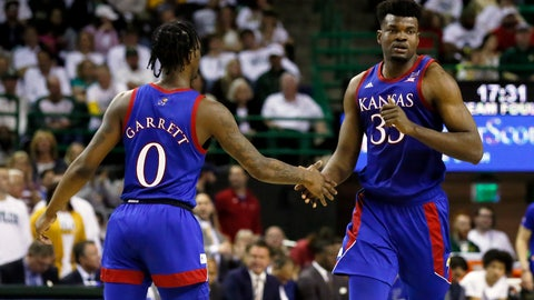 <p>               Kansas center Udoka Azubuike, right, low fives guard Marcus Garrett, left, after a made basket against Baylor during the second half of an NCAA college basketball game on Saturday, Feb. 22, 2020, in Waco, Texas.  (AP Photo/Ray Carlin)             </p>