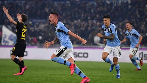 <p>               Lazio's Sergej Milinkovic-Savic, center, celebrates after he scored his side's second goal during the Serie A soccer match between Lazio and inter Milan, at Rome's Olympic stadium, Sunday, Feb. 16, 2020. (Alfredo Falcone/LaPresse via AP)             </p>