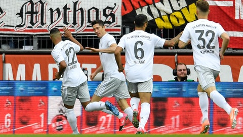 <p>               Bayern's Robert Lewandowski, 2nd from left, is celebrated after scoring the opening goal during the German Bundesliga soccer match between 1. FC Cologne and Bayern Munich in Cologne, Germany, Sunday, Feb. 16, 2020. (AP Photo/Martin Meissner)             </p>