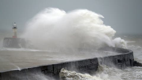 <p>               Waves crash into the wall at Newhaven south east England, as Storm Ciara, named by the Met Office national weather agency, hits the UK, Sunday Feb. 9, 2020. Trains, flights and ferries have been cancelled and weather warnings issued across the United Kingdom as a storm with hurricane-force winds up to 80 mph (129 kph) batters the region. (Andrew Matthews/PA via AP)             </p>